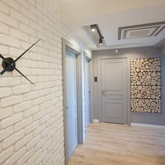 Mieszkanie Płock: styl , w kategorii Korytarz, przedpokój zaprojektowany przez Tektura Studio Katarzyna Denst