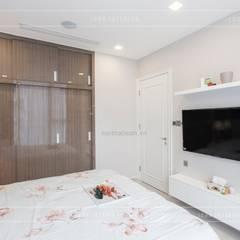 Thi công nội thất căn hộ Aqua 1 Vinhomes Golden River - Phong cách hiện đại:  Phòng ngủ by ICON INTERIOR
