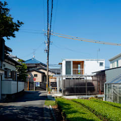 Single family home by すずき/suzuki architects (一級建築士事務所すずき)