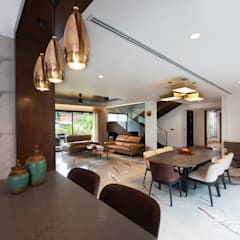 Lights.:  Dining room by Kembhavi Architecture Foundation