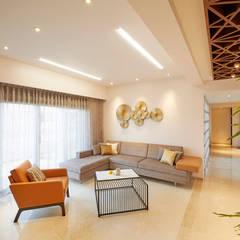 MR. RAKESH SHAH -3BHK APARTMENT @ PUNE:  Living room by Suchit Interiors & Associate