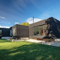 Black House:  Detached home by Adrian James Architects