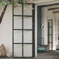 Can Escarrera 2: Ingresso & Corridoio in stile  di architetto stefano ghiretti
