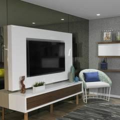 Remodelação de apartamento: Salas de estar  por AtelierAtelier