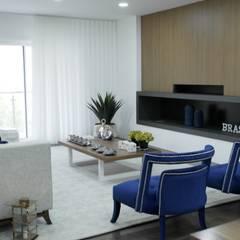 Remodelação, design e decoração de moradia: Salas de estar  por AtelierAtelier