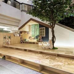 公共閱讀空間也能夠像家一樣舒適 - 高雄福華飯店 「想生活」:  商業空間 by 青易國際設計