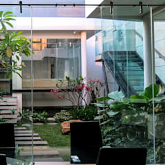 Glass | Green | Water:  Taman batu by AIGI Architect + Associates