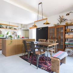 土間キッチンの家 house_in_nishiyama: タイラ ヤスヒロ建築設計事務所/taira yasuhiro architect & associatesが手掛けたダイニングです。