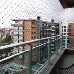 Redes de Proteção para varandas: Terraços  por ANTIKEDA