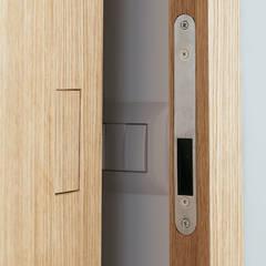 Puertas de madera de estilo  por manuarino architettura design comunicazione