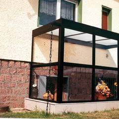 Kellereingangsüberdachung:  Terrasse von Montage & Design Gunter Uhlig