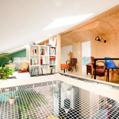 Habitat ouvrier: Salon de style  par Elisabeth Manguin Architecte