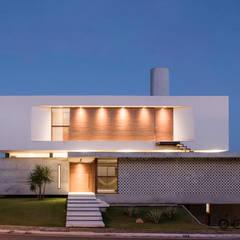 Casa IF: Casas  por Martins Lucena Arquitetos