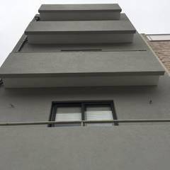 Growing - Engenharia e construção | Reabilitação de fachada de edifício - Vila do conde |: Condomínios  por Black Oak Company group|( Ooty. )( Timberman )( Growing )