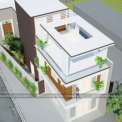 Nhà phố 2 mặt tiền:  Nhà gia đình by Công ty cổ phần tư vấn kiến trúc xây dựng Nam Long,