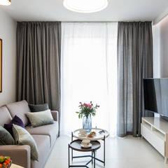 ELEGANCKA PRAGA: styl , w kategorii Salon zaprojektowany przez KODO projekty i realizacje wnętrz