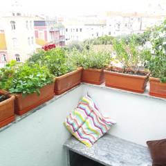 Apartamento T3 Duplex Penha França: Terraços  por EU LISBOA