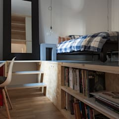Osb style: Camera da letto in stile  di ghostarchitects