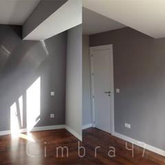 Reforma de vivienda en San Agustín, Burgos.: Salas multimedia de estilo  de Cimbra47