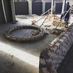Fireplace in construction:  Patios by TOP CENTRE PROPERTIES GROUP (PTY) LTD
