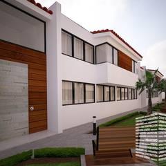 DEPARTAMENTOS CON TEJA: Condominios de estilo  por HHRG ARQUITECTOS