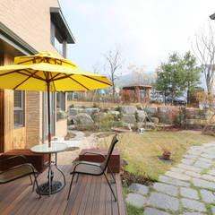타샤의 정원을 꿈꾸며 지은 원주혁신도시 집 by 주택설계전문 디자인그룹 홈스타일토토 모던 타일