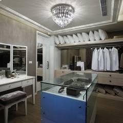 Dressing room by 雅群空間設計