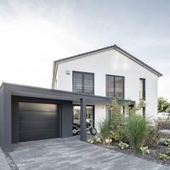 Single family home by wir leben haus - Bauunternehmen in Bayern, Modern