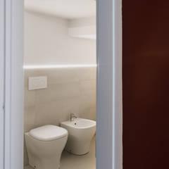 Casa Y: Bagno in stile  di camera24
