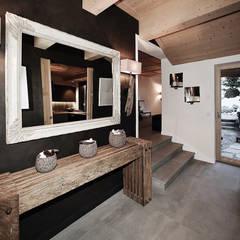 Hall d'entrée: Couloir et hall d'entrée de style  par Antoine Chatiliez