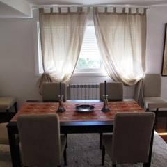 Apartamento T2 Avenidas Novas: Salas de jantar  por EU LISBOA
