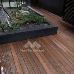 Balcones y terrazas de estilo asiático de 新綠境實業有限公司 Asiático Compuestos de madera y plástico