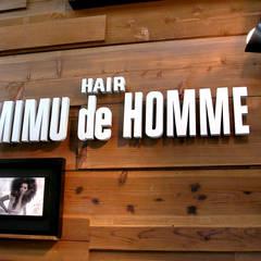 Hair MIMU de HOMME ヘアーミム・デ・オム新都心店: Arms DESIGNが手掛けた商業空間です。