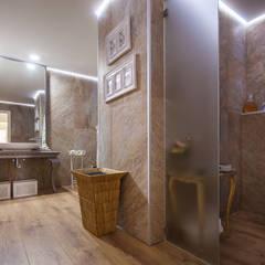 Badezimmer von Atelier d'Maison