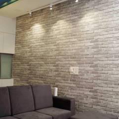 Raheja Vista Pune:  Living room by decormyplace