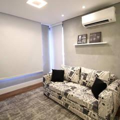 So´fá cama: Salas de estar  por Serra Vaz Arquitetura e Design de Interiores