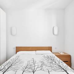 Reubicación : Dormitorios de estilo  de Luxiform Iluminación