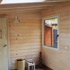 Caseta de madera habitable en Segovia: Salones de estilo  de Casetas de Madera