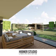 Projekt nowoczesnego ogrodu, Warszawa: styl , w kategorii Taras zaprojektowany przez Hibner Studio