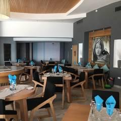 Restaurante Rosinella , The Reef Coco Beach: Restaurantes de estilo  por MoisesMedinaDesign