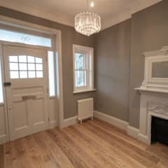 HOUSE EXTENSION AND LOFT CONVERSION WITH FULL HOUSE REFURB IN KEW:  Corridor & hallway by The Market Design & Build