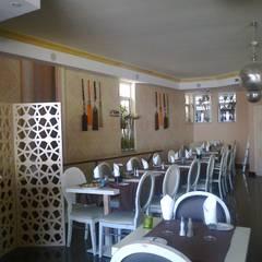 Remolelação Restaurante Doce Jardim: Espaços de restauração  por Atelier  Ana Leonor Rocha