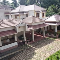 Top Construction Company in Thrissur:  Country house by Prithvi Homes
