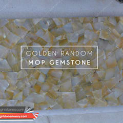 Golden Mother of Pearl slabs- height stones luxury:  Dining room by Height Stones
