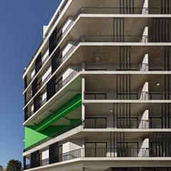 Proyecto de Viviendas para la Villa Olímpica por SMF Arquitectos: Casas multifamiliares de estilo  por SMF Arquitectos  /  Juan Martín Flores, Enrique Speroni, Gabriel Martinez,Moderno
