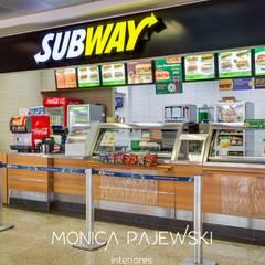 SUBWAY AEROPORTO AFONSO PENA : Espaços gastronômicos  por Monica Pajewski Interiores