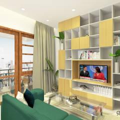 Rumah Krembangan: Ruang Keluarga oleh SEKALA Studio,