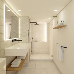 Apartamento em Lisboa: Casas de banho  por im.lab