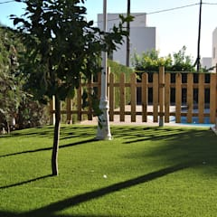Instalación de césped artificial de calidad en Madrid: Jardines de estilo  de Albergrass césped tecnológico