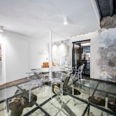 Estudio Diseño De Interiores: Oficinas y Tiendas de estilo  de JUANCHO GONZALEZ